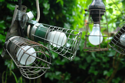 collection of vintage industrial lights hanging in a row