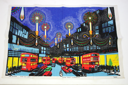 vintage tea towel featuring a London scene with a crowd of double decker buses at night around Christmastime, probably Oxford Street