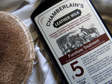 bottle of Chamberlain's Leather Milk No. 5 with used applicator pad