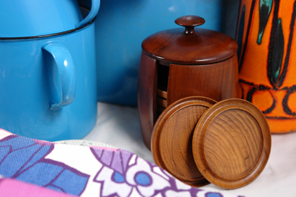 selection of antique & vintage homewares bought at Lincoln Show highlighting a set of 1950s teak coasters in a matching lidded holder