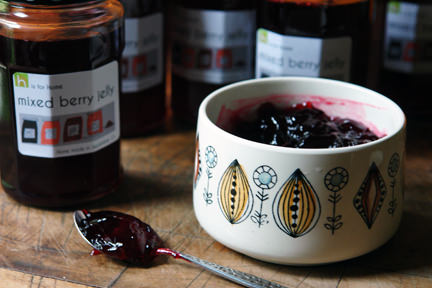 Jars of mixed berry jelly with some decanted into a vintage Egersund bowl