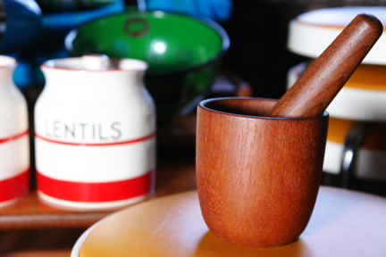 detail of small teak Scandinavian mortar &amp; pestle