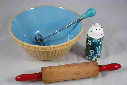 group of vintage kitchenalia items soon to be added to the H is for Home website including a wooden rolling pin with red handles, pottery mixing bowl with blue interior, pottery sifter made by Portmeirion and a metal swizzle stick with blue painted wooden handle