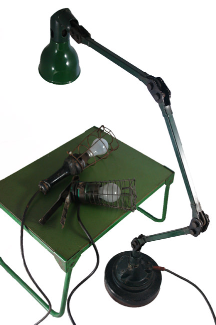 selection of vintage industrial industrial lamps and green metal table