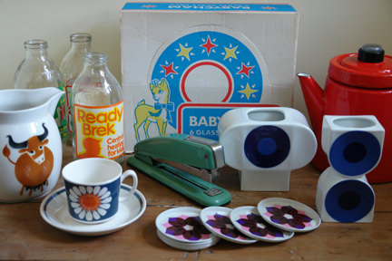 selection of vintage homewares including Babysham party pack in original packaging, red enamel Finel coffee pot designed by Anti Nurmesniemi, Arabia milk jug, pair of staplers, trio of milk bottles, Figgjo Flint Turi Daisy cup & saucer, set of tin drink coasters and trio of Altenkunstadt pottery vases designed by Cari Zalloni
