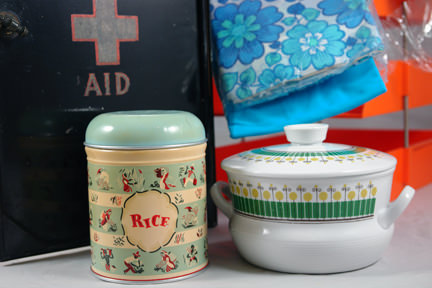 selection of vintage homewares soon to be for sale in the H is for Home shop including large tin first aid box; orange, 3-tier filing tray; ceramic Gie Gantofta rice jar; Worcester Ware rice storage tin; Rorstrand Pottery &quot;Wasa&quot; lidded bowl; pair of 1970s Bri-Nylon floral bedding sets