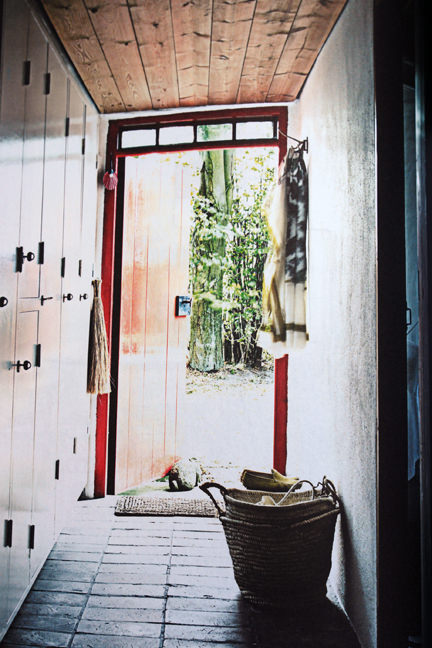 page from the 'Artistic Idyll' feature showing the hallway from the launch issue of Elle Decoration Country