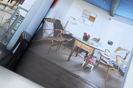 page from the 'Artistic Idyll' feature showing a table and set of chairs from the launch issue of Elle Decoration Country