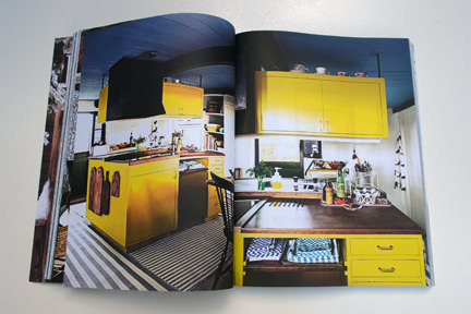 "page from the ""Artistic Idyll"" feature showing the yellow and blue kitchen from the launch issue of Elle Decoration Country"