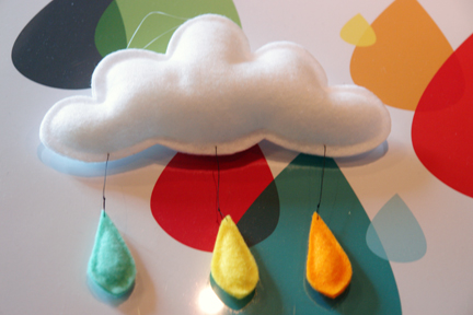 detail of white felt cloud and multicoloured rain drop mobile on rain rain, go away poster