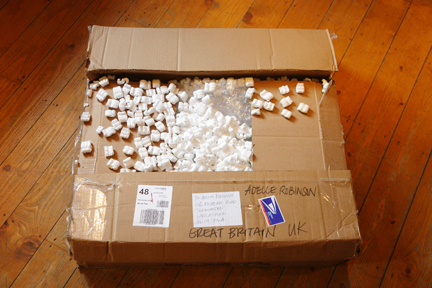 large cardboard box with overflowing packing beads