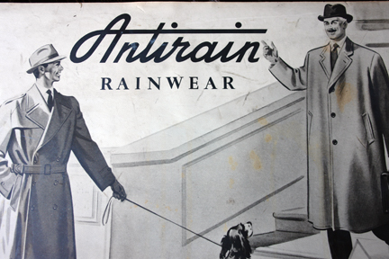 detail from a  vintage shop advertising sign for Antirain Rainwear