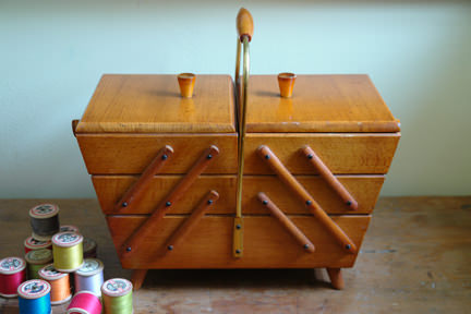 vintage wooden sewing box with reels of thread