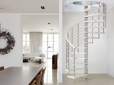 white metal and stainless steel spiral staircase