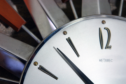 detail of vintage Metamec starburst clock