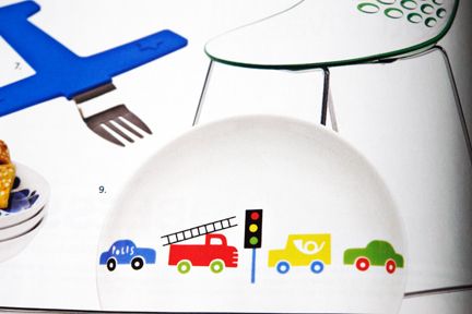 page from contemporary Swedish interiors magazine featuring colourful childrens plate & cutlery