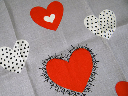 detail from a Tammis Keefe teatowel with red & white hearts