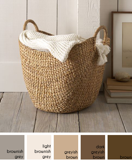 West Elm water hyacinth basket containing a knitted throw