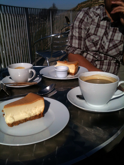 slices of cheesecake & cups of coffee on the terrace of the Holmfirth Vineyard restaurant