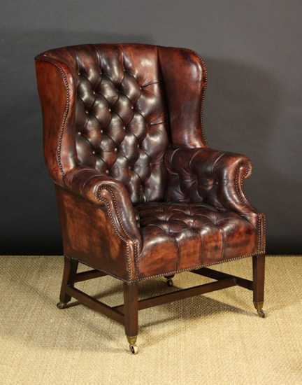 Georgian leather wing back armchair sold at Wilkinson's Auctioneers, Doncaster