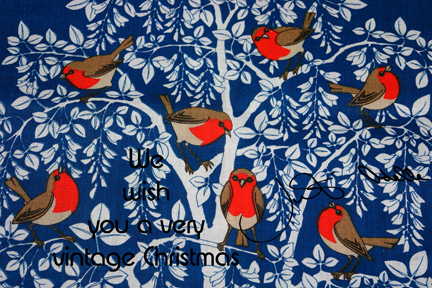 vintage linen teatowel decorated with 7 robin red breasts in a white tree