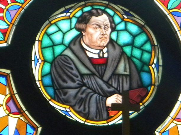 Martin Luther s Ninety Five Theses   History Today Martin Luther on glass in church of Martin Luther in Murska Sobota   Slovenia