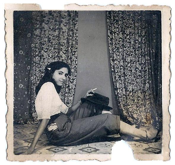 """My mother, Mohini Goklani. Pune, Maharashtra. Circa 1950"" Image of a Mohini Goklani who would have herself photographed (in confidence) as 'liberal' . Copying Indian Film stars, they wore pants and holding a cigarette (1950).  Image and Text contributed by Sunita Kripalani, Goa http://www.indianmemoryproject.com/80/"