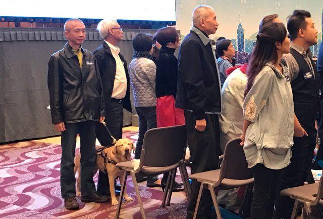導盲犬協會副主席曾建平早前帶同導盲犬Deanna出席林鄭月娥造勢大會