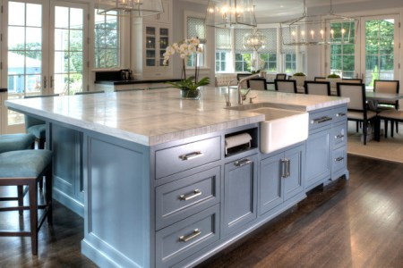 kitchen island. kitchen island. large kitchen island with farmhouse sink paper towel holder super white quartzite countertop and furniture like cabinet. kitchen island