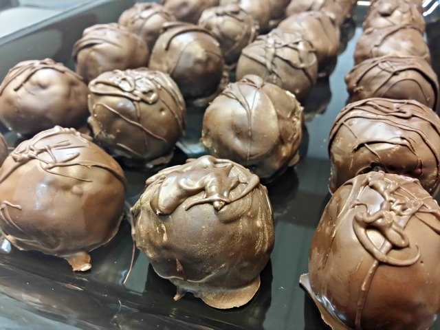Chocolate chip cookie dough truffles on display