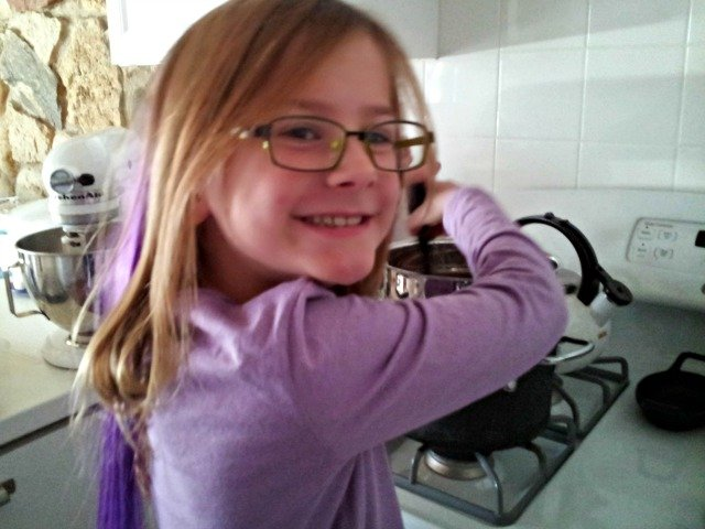 Little Miss helping to melt chocolate