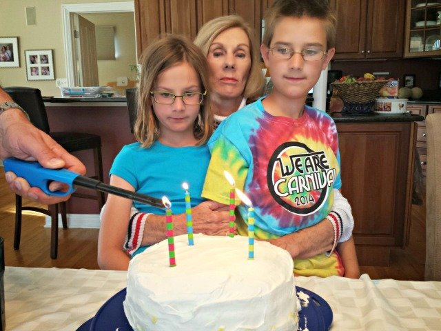 Blowing out the candles for 70th birthday