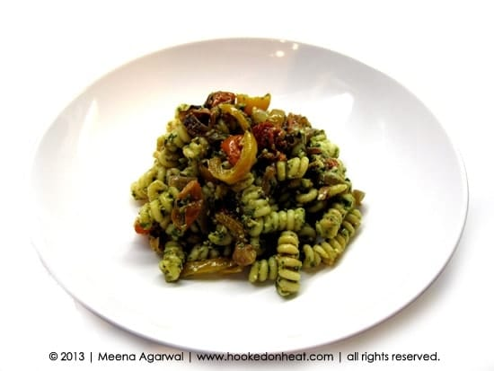 Recipe for Pesto Pasta taken from www.hookedonheat.com. Visit site for detailed recipe.