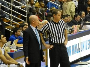 Seton Hall head coach Kevin Willard discusses a play with official Nathan Ferrell (Ray Floriani photo)