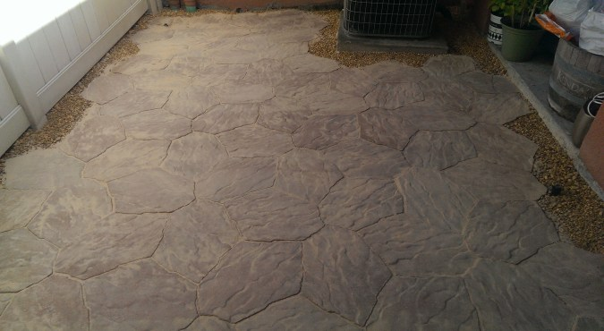 Beautiful! All I need to do is use a garden hose in the shower setting. The wet polymeric sand will cure and bind the stones together.