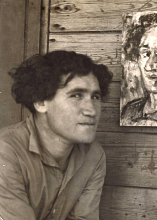 Artist Chaim Atar with his self portrait, Ein Harod, late1930s