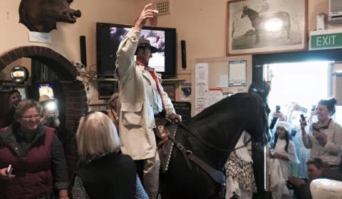"""Johnny Gilbert"" and his horse enjoy a beer in the bar"