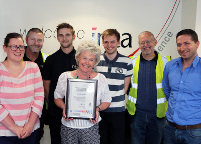Inta staff with the safety certificate