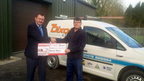 Simon Dixon (right) accepts his prize