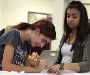 During the Muslim Student Association event after school on Nov. 4, sophomore Sandy Kaur gets a henna tattoo. The fundraiser aimed to bring in money in order for the club, which recieves no funding otherwise, to host future cultural events and lower the cost of MSA t-shirts.