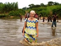 Becky crossing a river