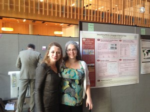 Becky standing with Sara at a poster presentation of their shared research at the University of Oregon Graduate Forum on February 20. 150 graduate students presented their research in this cross-discipline forum.