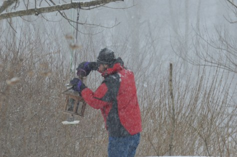 Image of Will feeding birdfeeder
