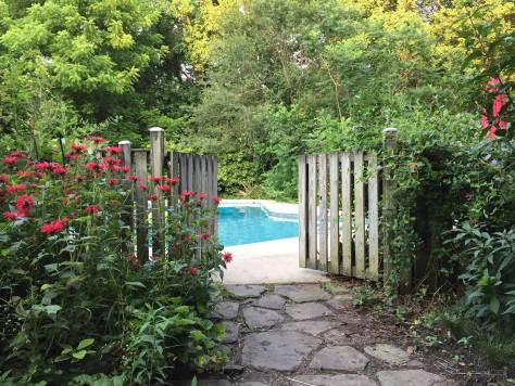 Image of swimming pool gate from patio garden