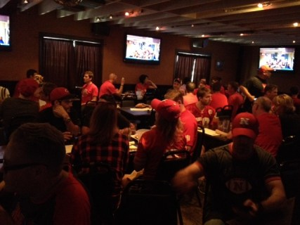 husker fans at a bar during football game