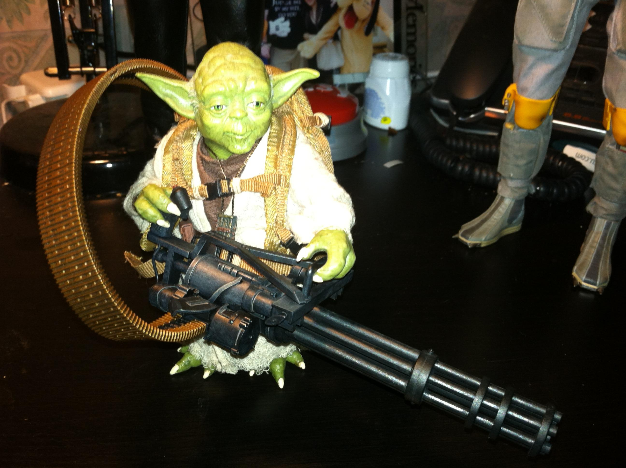 Yoda holding an unconventional weapon.