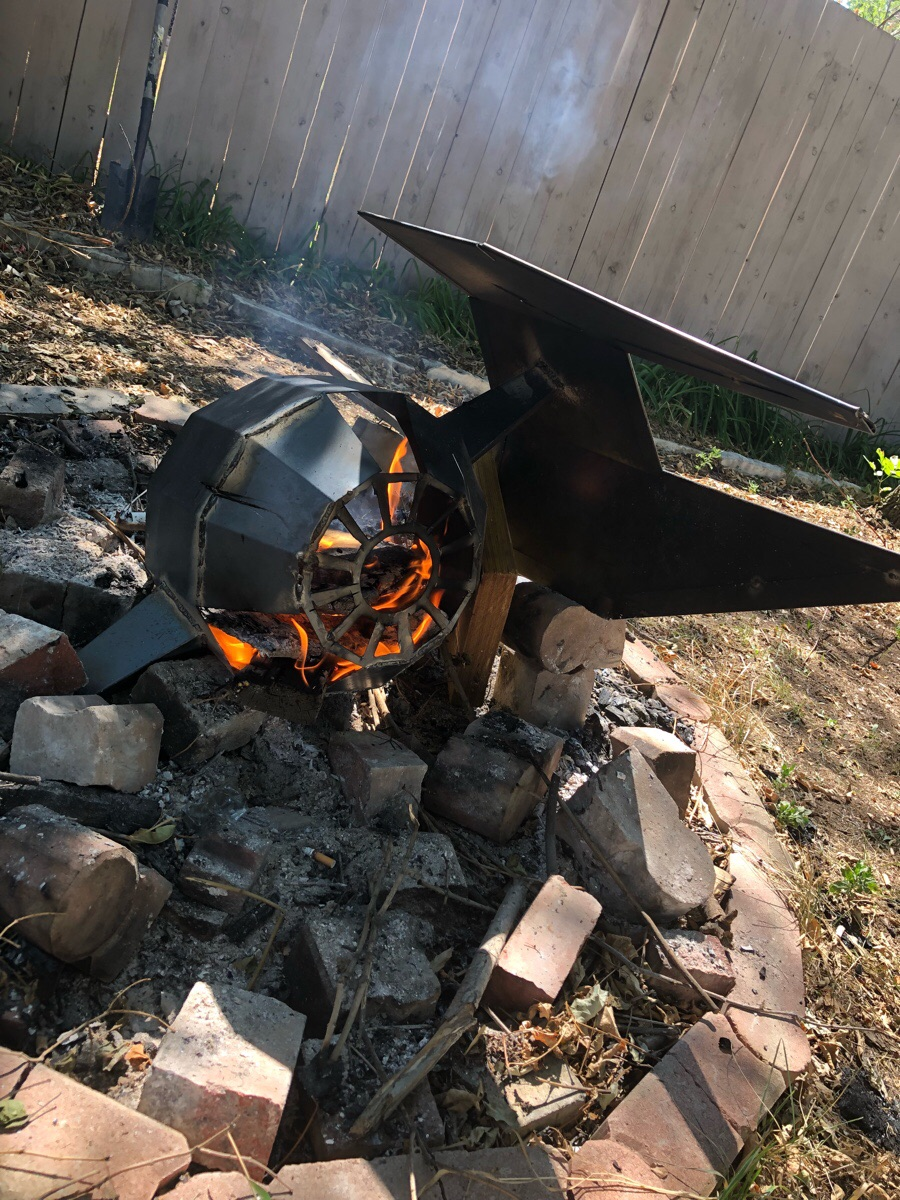 Made a feature for my fire pit. A crashed tie interceptor.