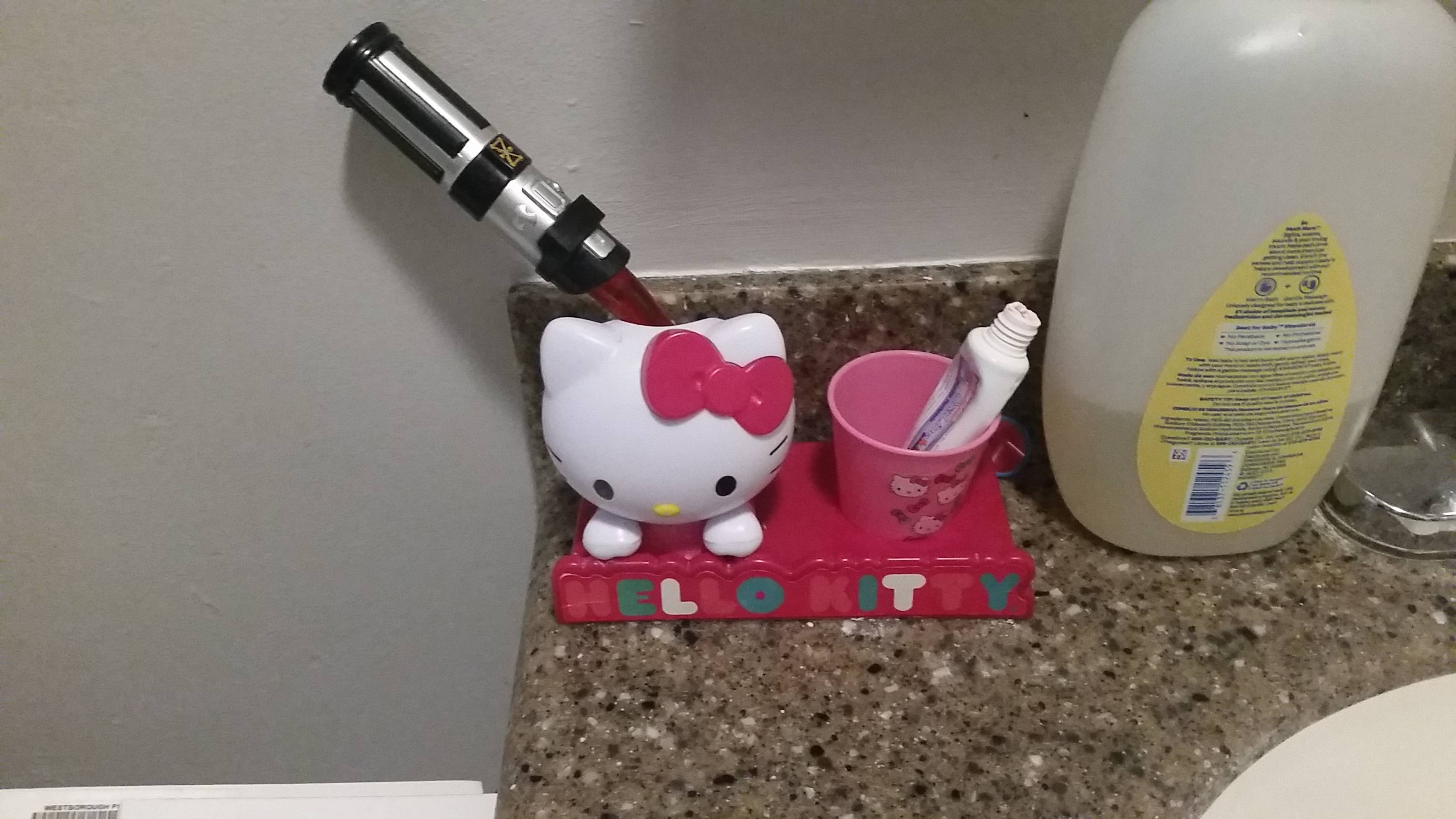 My daughter\'s tooth brush and toothbrush stand makes it look like Hello Kitty lost a duel with Darth Vader