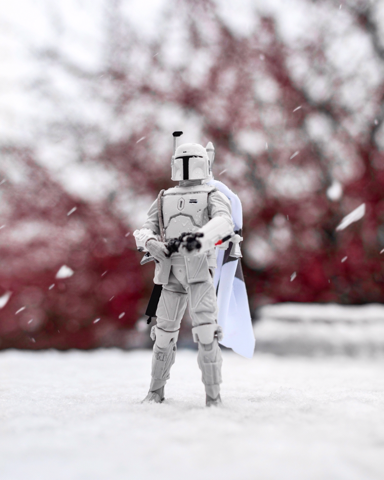 Took a photo of my coworkers Boba Fett action figure in the snow, love how it turned out