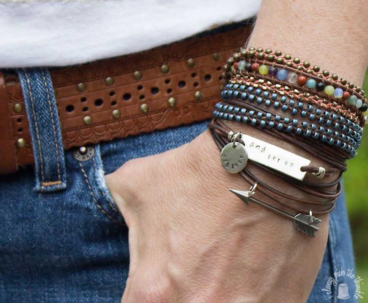 leather-wrapped-arrow-bracelet-stack-of-bracelets-close-up